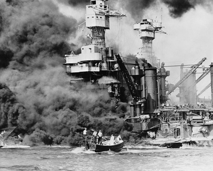 The USS West Virginia, Miller's ship, ablaze at Pearl Harbor.